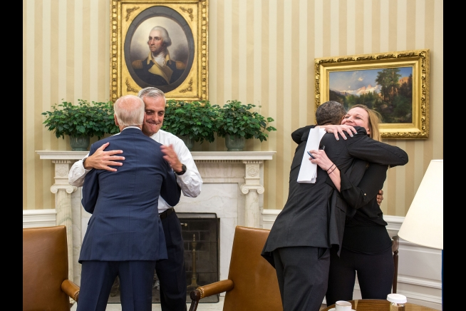 President Obama hugs Kristie Canegallo and Vice President Biden hugs Denis McDonough President Barack Obama hugs Kristie Canegallo, Deputy Chief of Staff, and Vice President Joe Biden hugs Chief of Staff Denis McDonough as they celebrate the Supreme Court ruling on Affordable Care Act subsidies in the Oval Office, June 25, 2015. (Official White House Photo by Pete Souza)