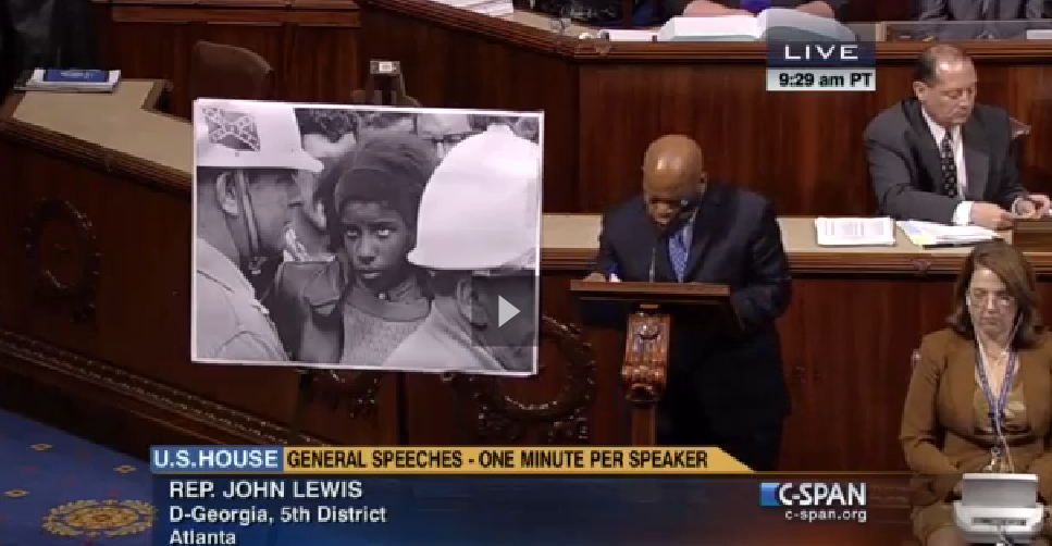 Rep. John Lewis, D-Georgia, reminds Congress about the use of the Confederate Flag against African Americans who were standing up for their civil rights. (C-SPAN photo)